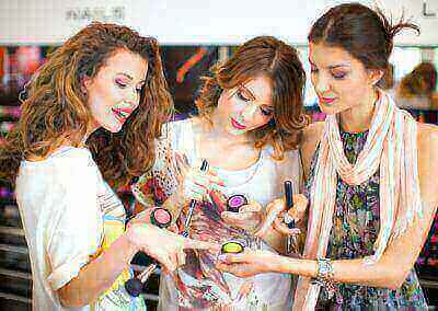 Young women in cosmetic store.