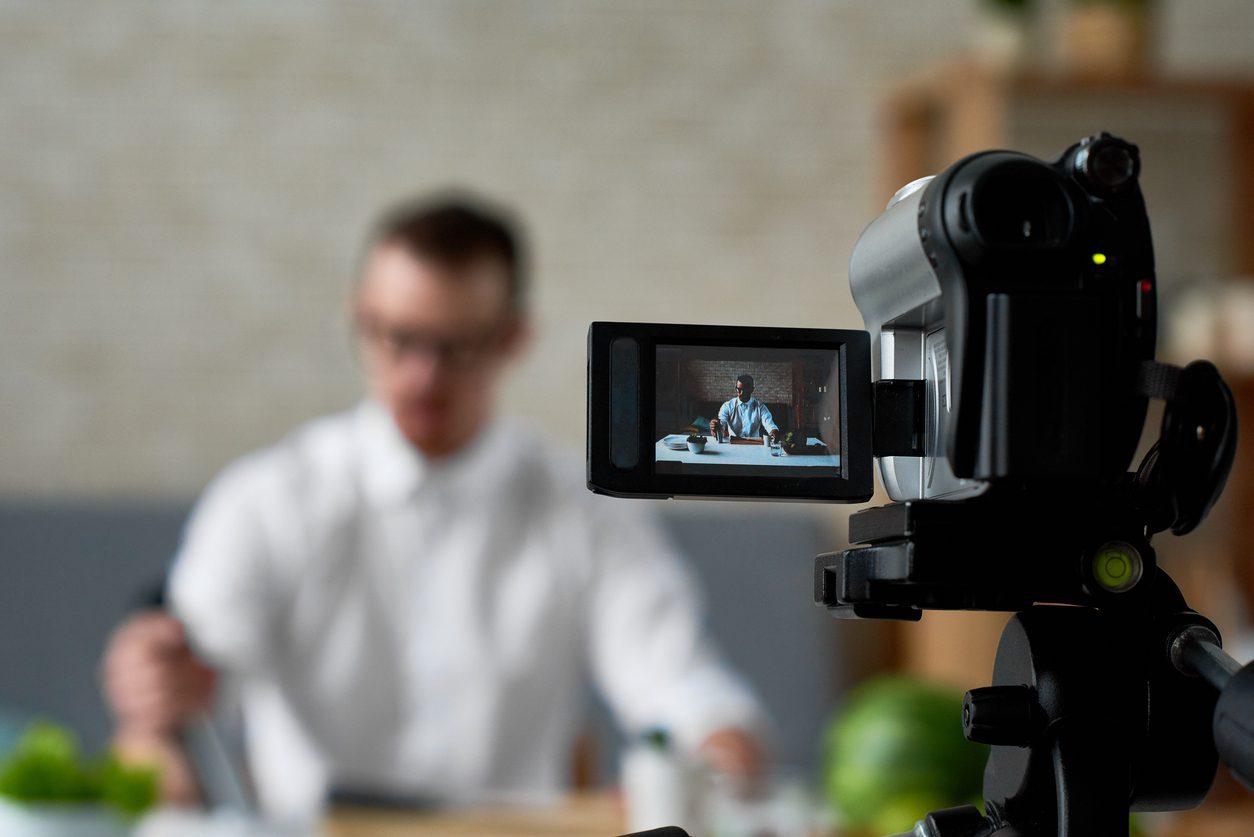 man-being-filmed-vlogging