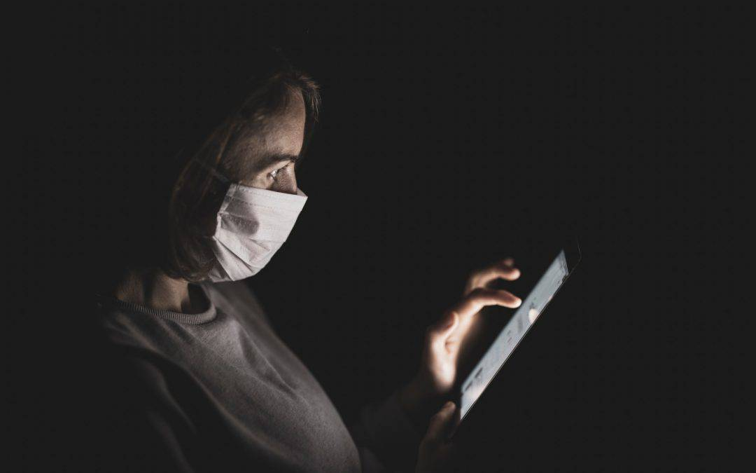 Lady with mask watching video